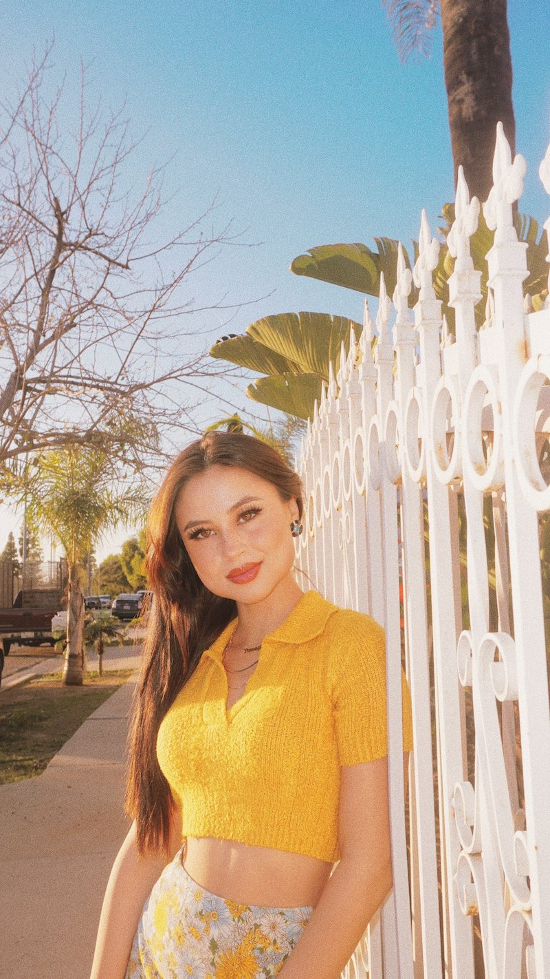 tiger lily press photo outside wearing a yellow summer outfit