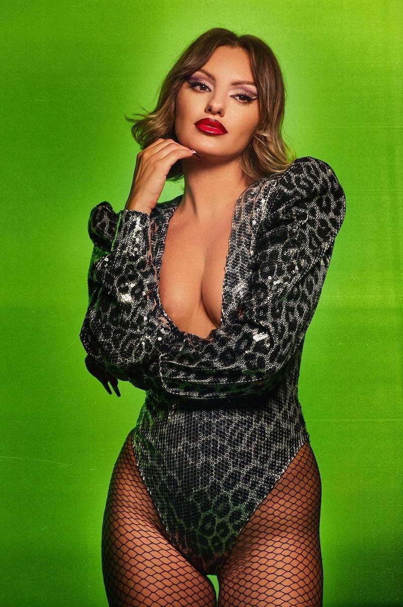 Alexandra Stan press photo wearing a revealing outfit