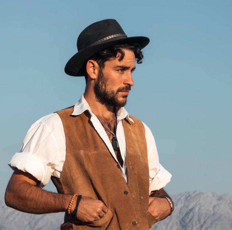 Amit Benita press photo outside wearing a black hat