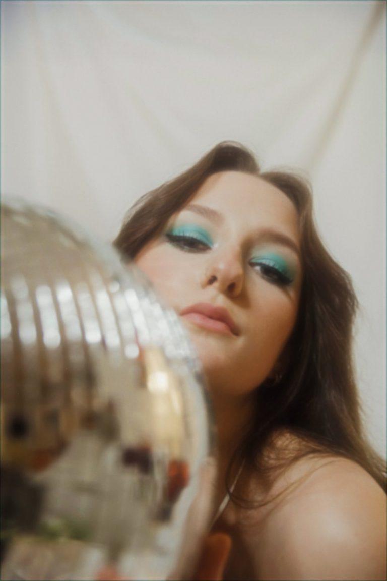 Frankie Maurie press photo behind a glittery object
