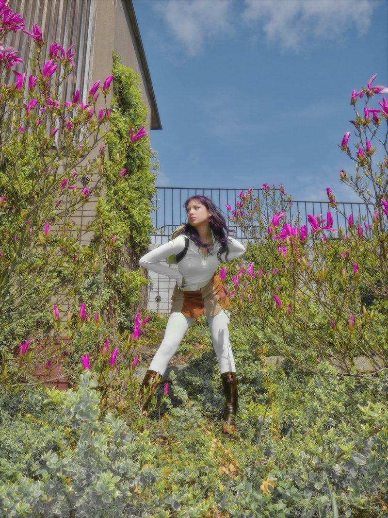 Klara Zangerl press photo outside surrounded by flowers
