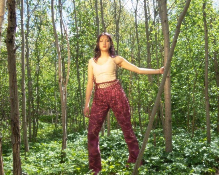 Klara Zangerl press photo outside in the woods