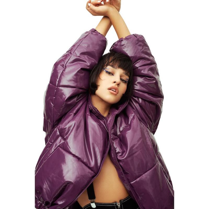 Holy Molly press photo wearing a purple jacket