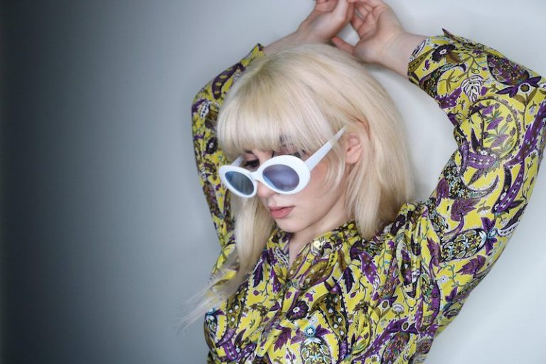 Izabel press photo wearing fashion glasses