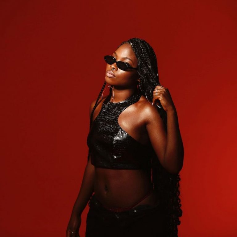 Ria Sean press photo with red background MAIN