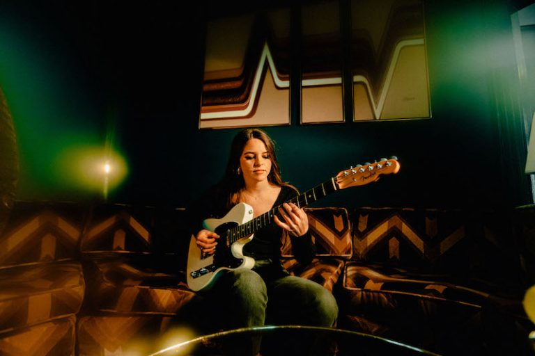 Shannon Lauren Callihan press photo playing a guitar