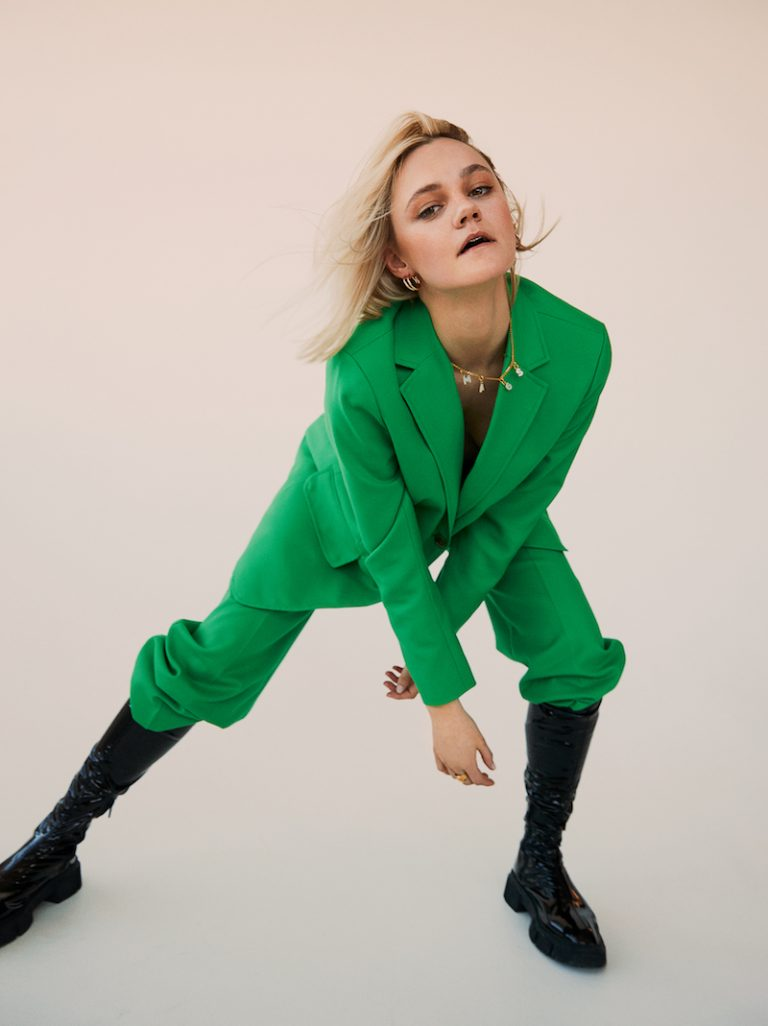 mags press photo wearing a green outfit